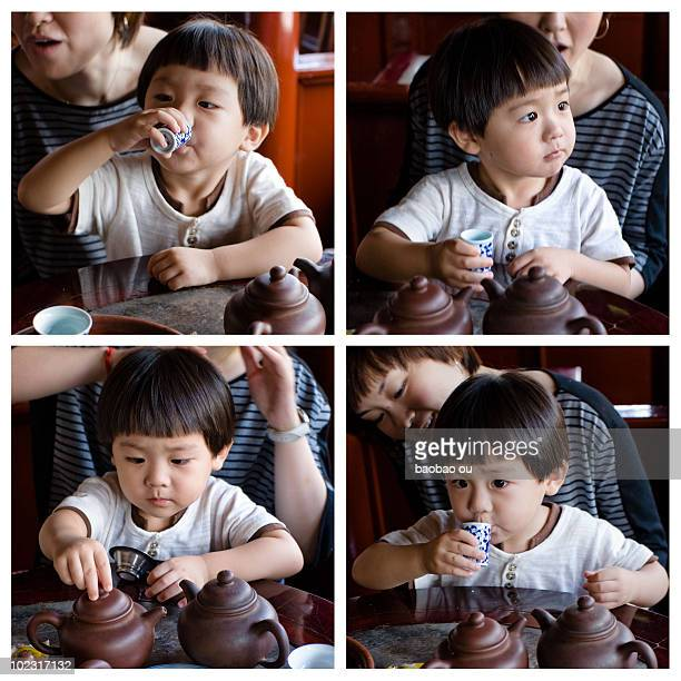 Little boy drinking tea