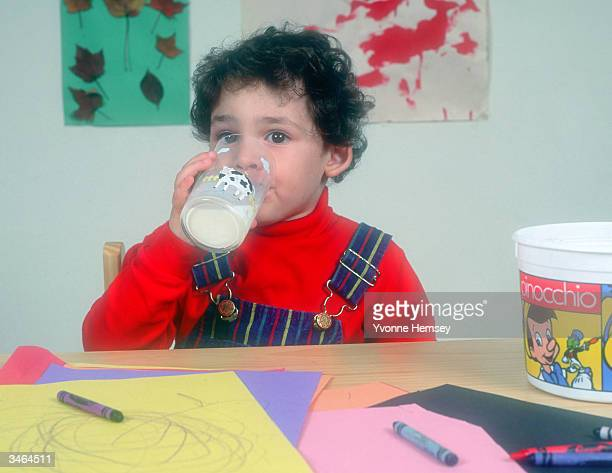 A little boy drinks a glass of milk October 1 1993 in New York City