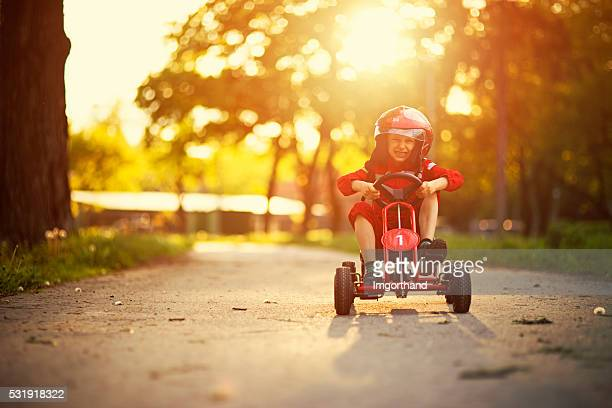 Little boy driving a go-kart