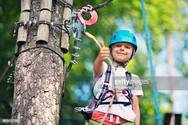 Little boy during in canopy tour