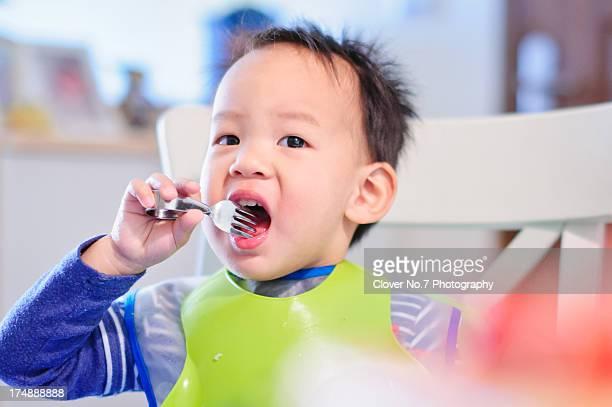 Little boy eat.