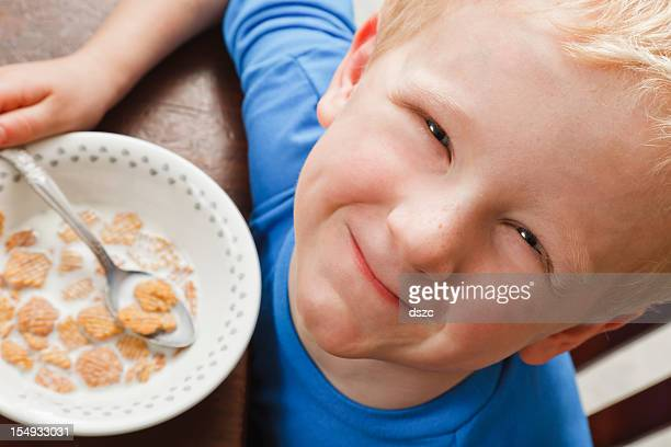little boy eating breakfast cereal