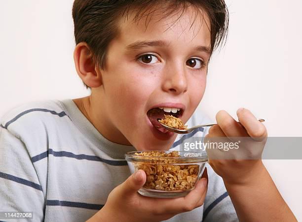 little boy eating cereal