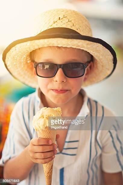 Little boy eating ice cream.