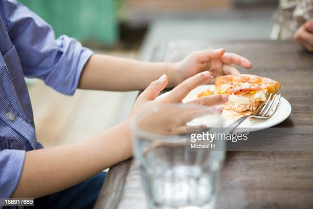 Little boy  eating slices of pizza