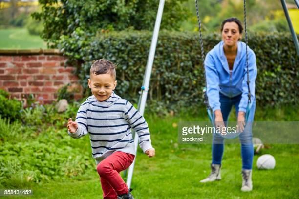 Little boy enjoying in the garden