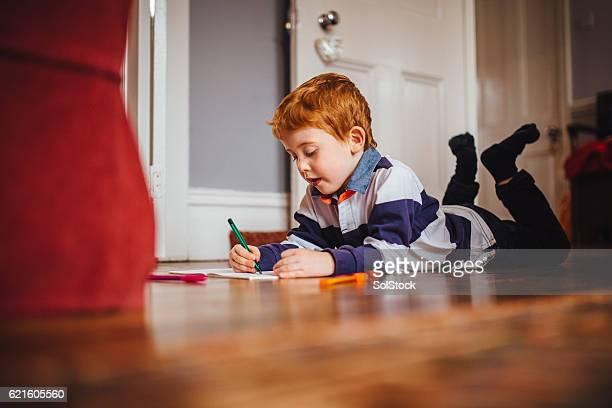Little Boy Enjoying Writing at Home