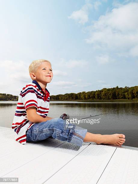 Little Boy Fishing from a Dock
