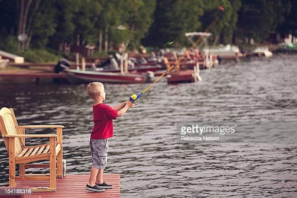 Little boy fishing off of pier