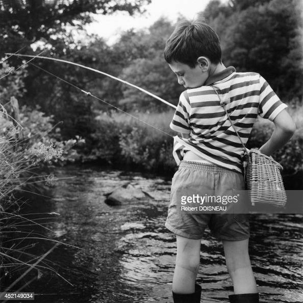 Neuvic d 39 ussel stock photos and pictures getty images for Little boy fishing