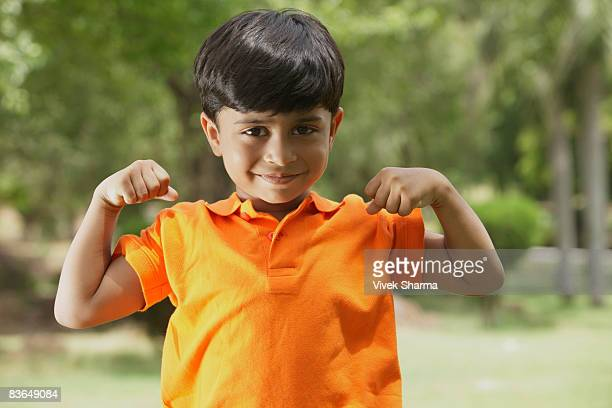 little boy flexing muscles