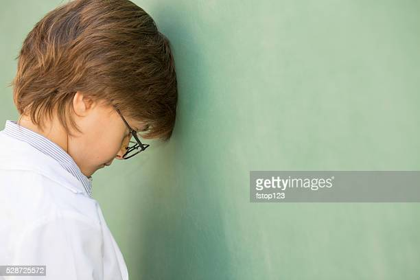 Little boy frustrated with school, education.