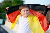 Little boy - Germany national football team fan - supporter on the stadium