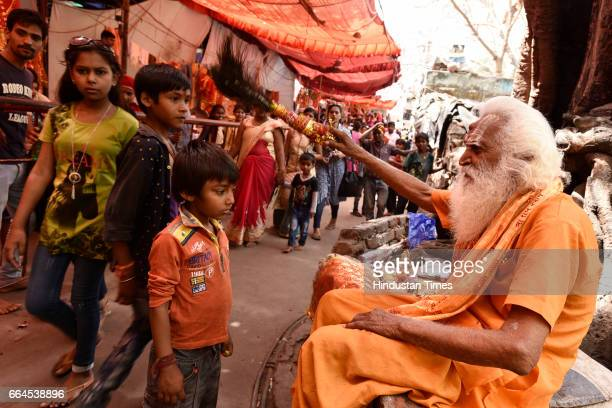 A little boy gets blessings from a priest at Kalkaji Mandir on Asthami the eighth day of the festival of Navratri on April 4 2017 in New Delhi India...