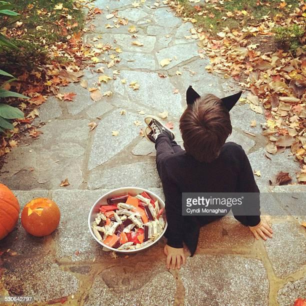 Little Boy Handing out Halloween Candy