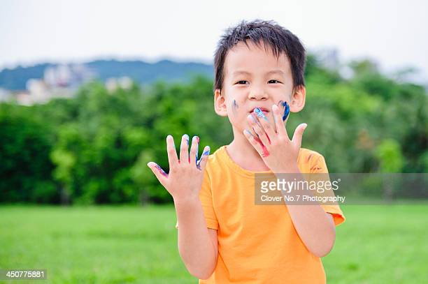 Little boy hands stained with watercolor