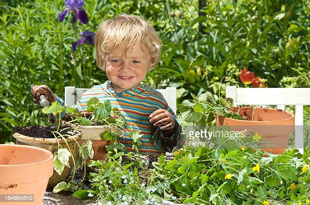 Little boy happy making a mess in the garden