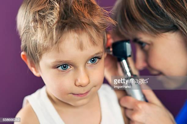 Little boy having an ear exam.