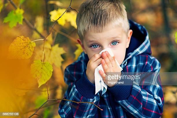 Little boy having autumn cold