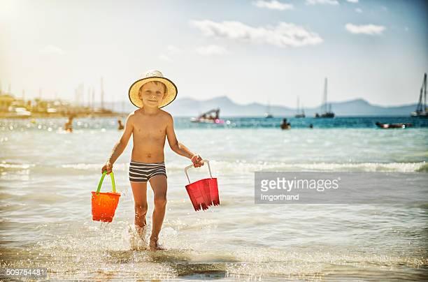 Little boy having beach fun