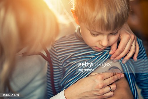 Little boy having medical examination at home
