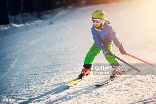Little boy having ski lesson