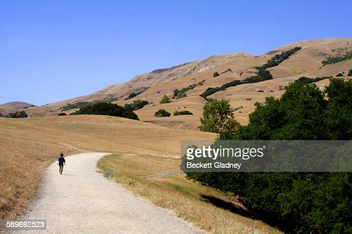 Little boy hikes in California foothills