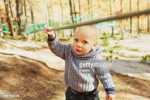little Boy holding a rope at a High Rope Course : Stock Photo