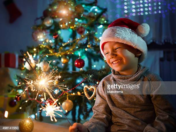 Little boy Holding Christmas Sparkler