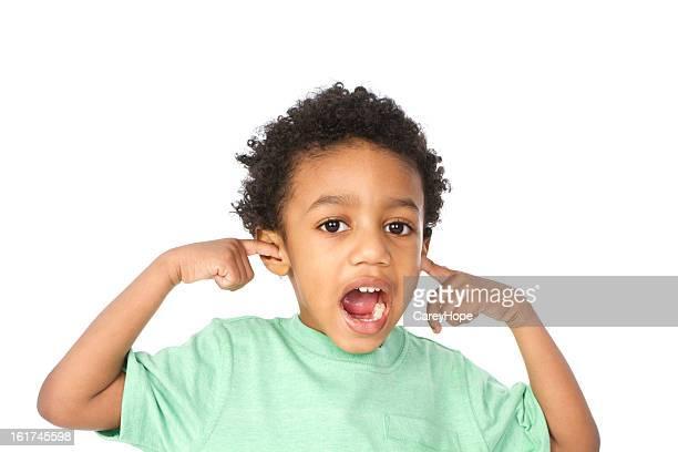 little boy holding ears