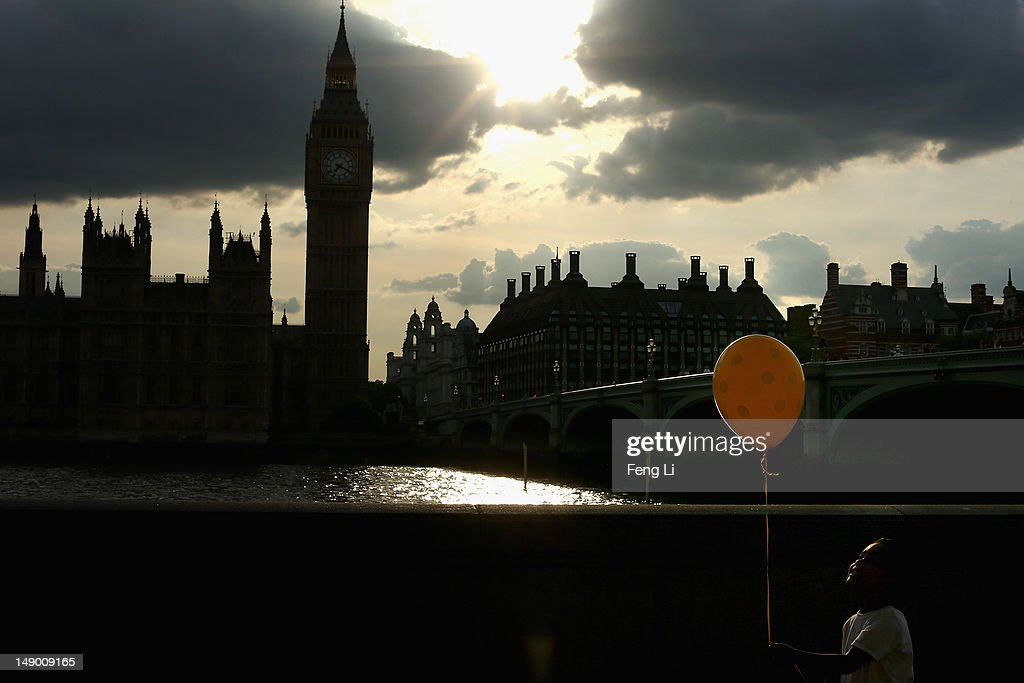 A little boy holds a balloon near the Houses of Parliament and Big Ben on July 21, 2012 in London, England. The opening ceremony of London 2012 Olympic Games will take place on July 27, 2012.