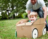 Little Boy in a Cardboard Car