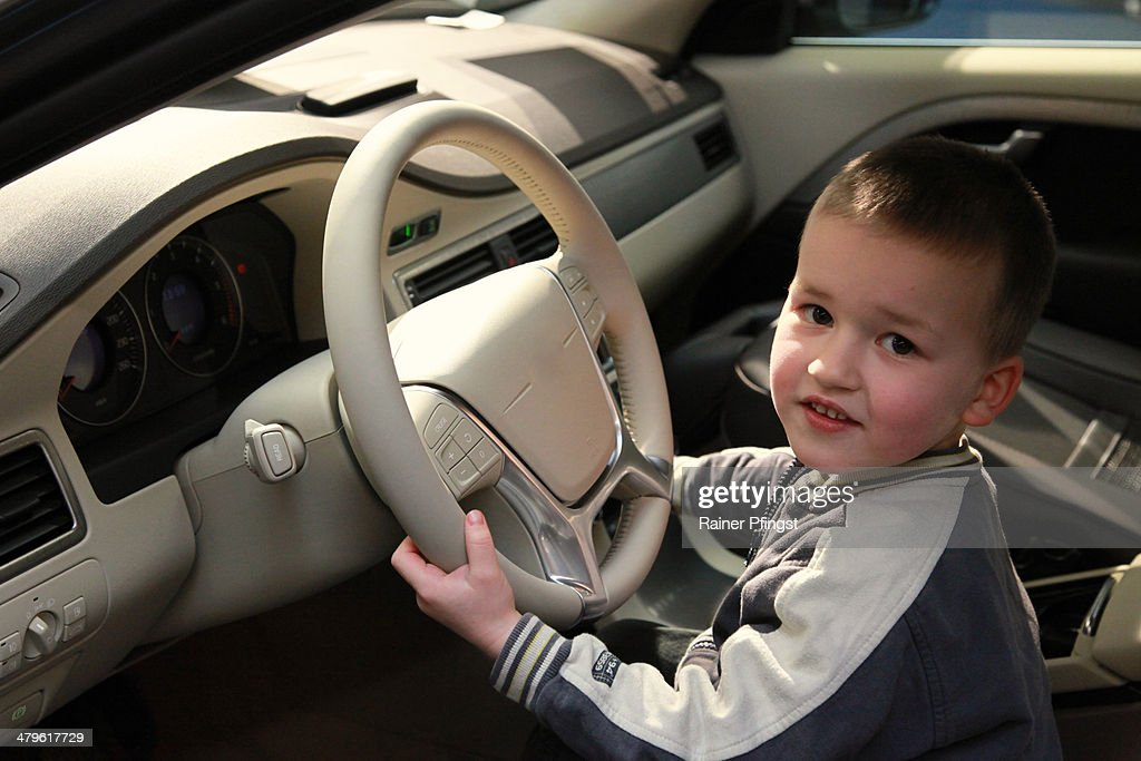 Little boy in a new car. : Stock Photo