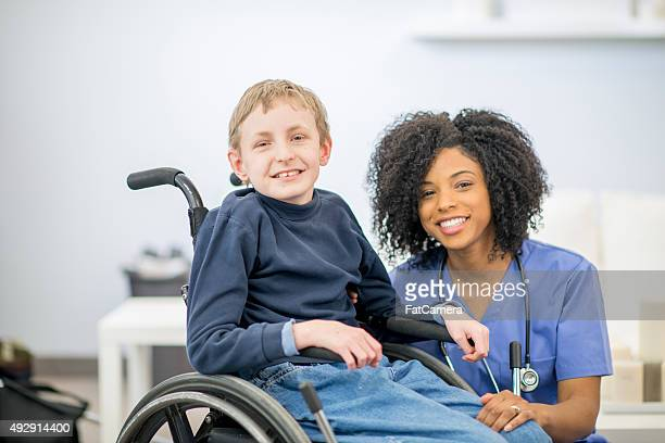 Little Boy in a Wheelchair with A Nurse