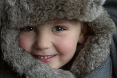 Portrait of a Child in a Fur Hat. Winter Concept