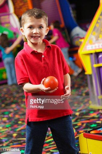 Little Boy in an Amusement Arcade