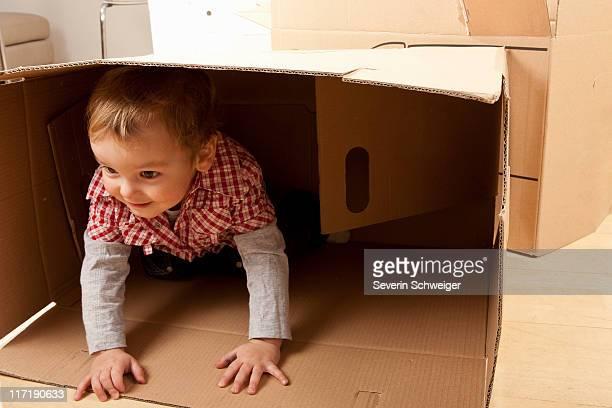 Little boy in packing case