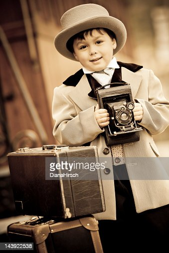 little boy in retro style with an old camera : Stock Photo