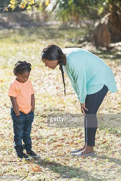 Little boy in trouble, mom scolding