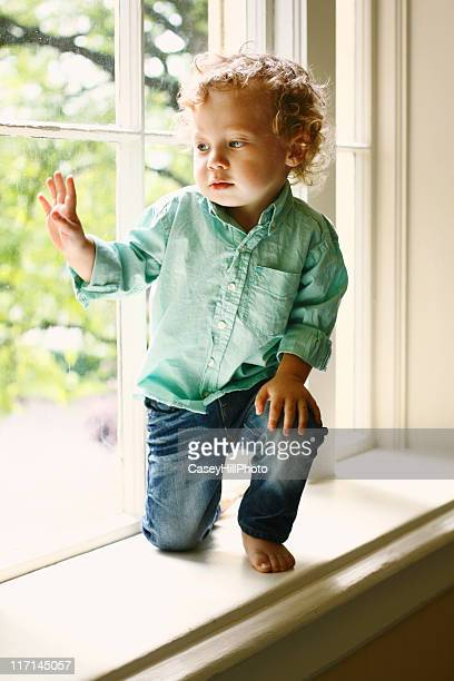 Little Boy in Windowsill
