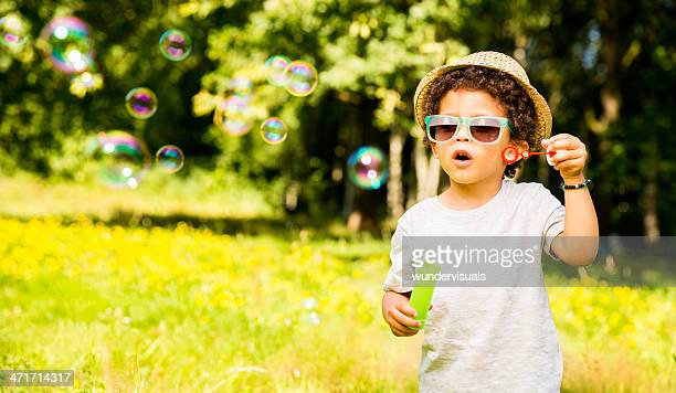 Little Boy is amazed by bubbles
