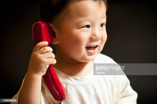 Little boy is talking on phone