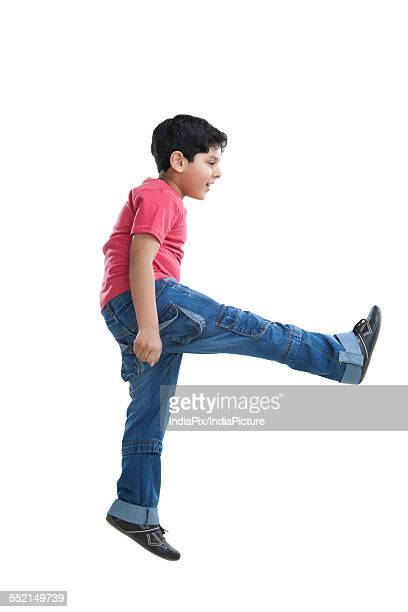 Little boy jumping in the air
