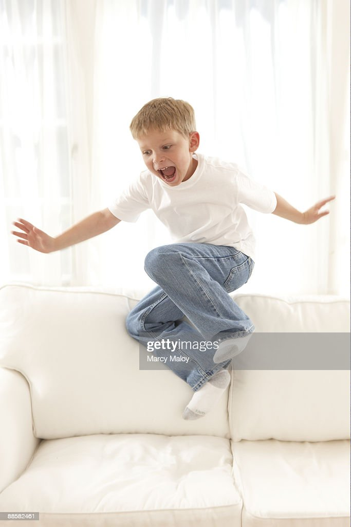 Little Boy Jumping On A Couch Stock Photo Getty Images