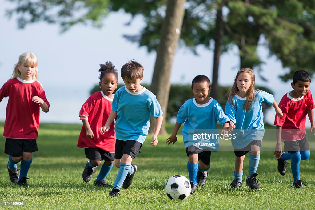 Little Boy Kicking a Soccer Ball : Stock Photo