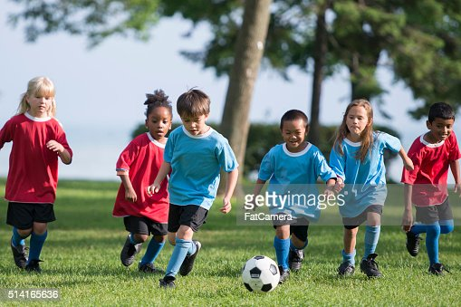 Little Boy Kicking a Soccer Ball