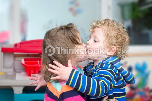Little boy kiss a little girl stock photo thinkstock little boy kiss a little girl stock photo altavistaventures Images