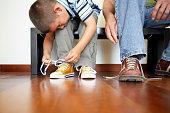 Little Boy Lacing his Shoes