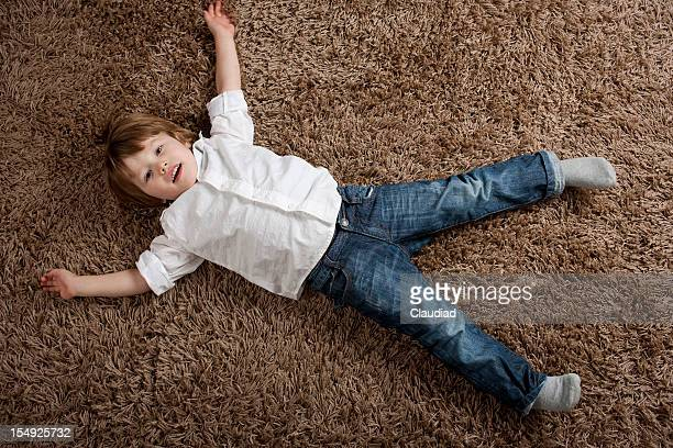 Little boy laying on the ground