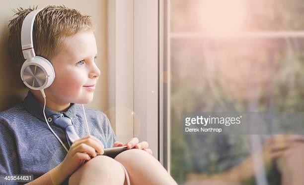 Little Boy Listening to music